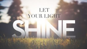 Let Your Light Shine text over a bright sunrise